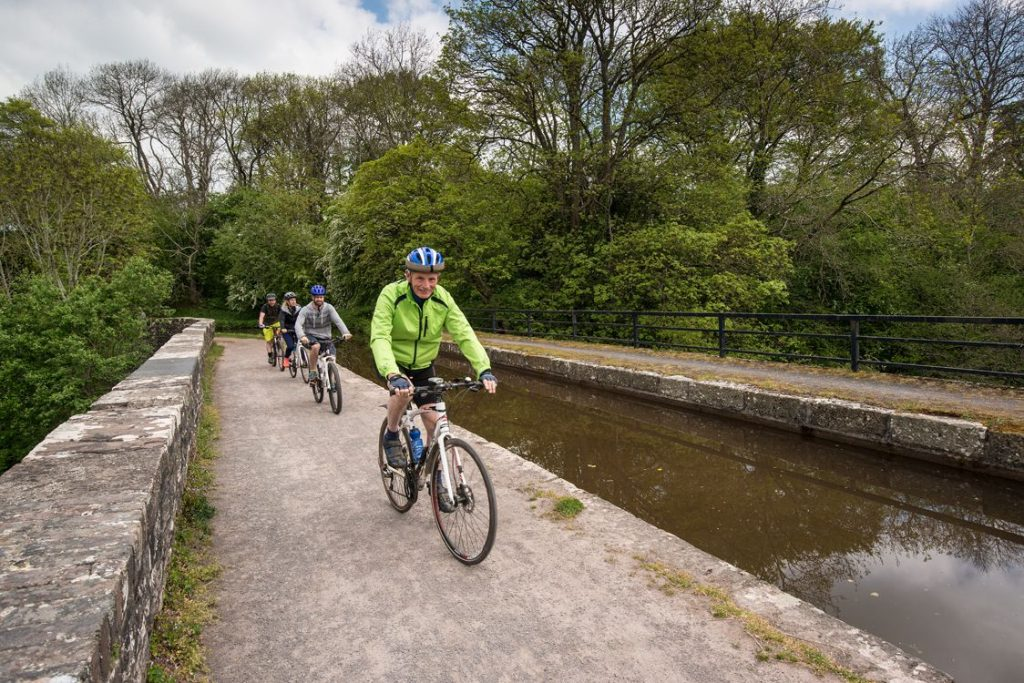 Cyclists near canal