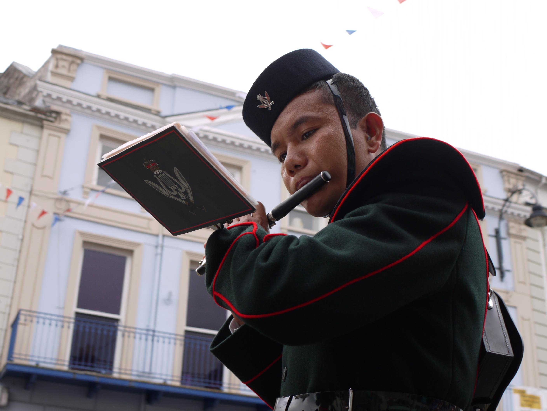 Gurkha soldier playing flute